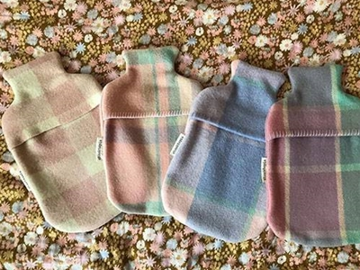 chooktopia makes cosy hot water bottle covers