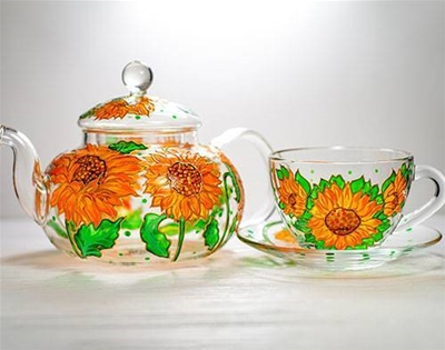 feast your eyes on these painted glass tea sets