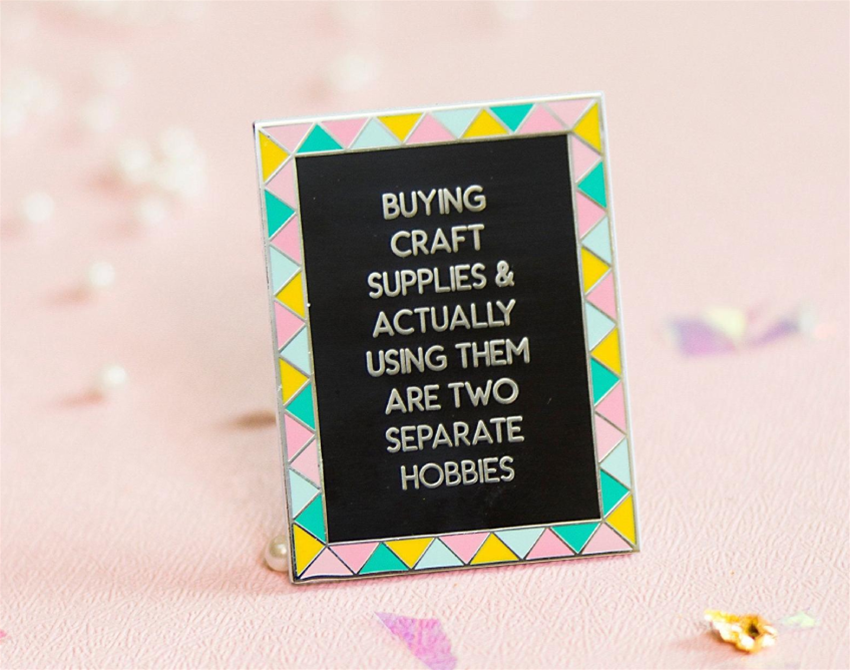 craft facts in the form of an enamel pin
