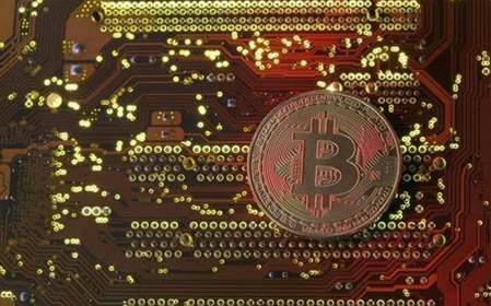 Bitcoin surges above US$12,000 to record high