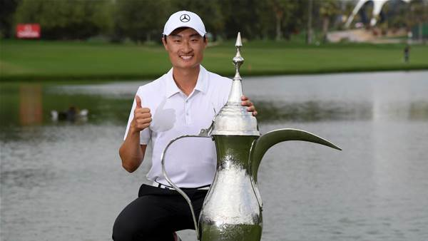 Li edges out McIlroy to win in Dubai