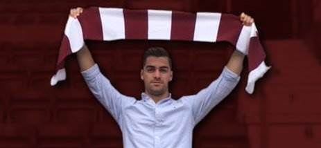 Adelaide defender signs with Hearts