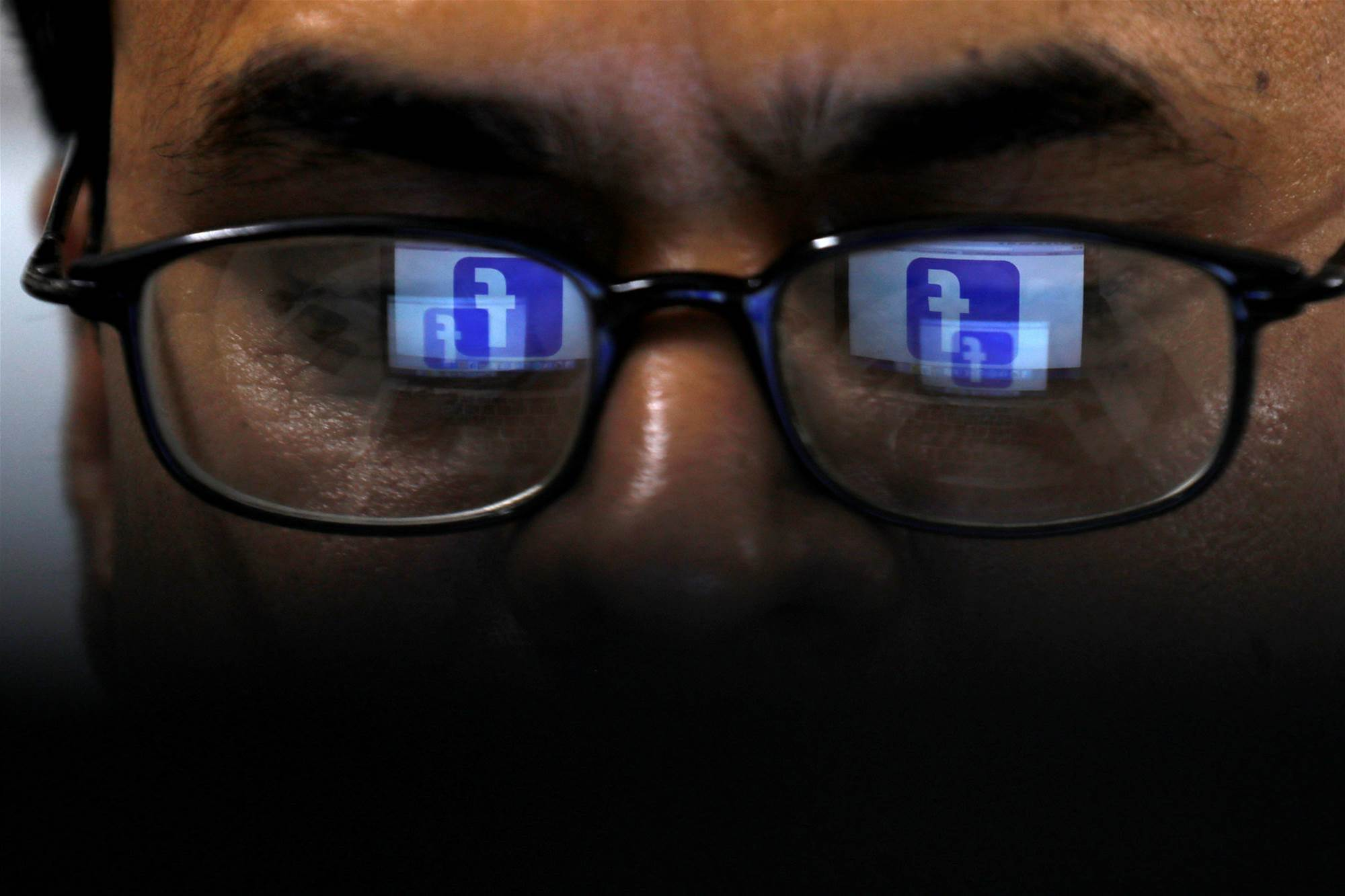 Britain plans social media watchdog to battle harmful content