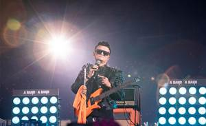 Tearful Ma bids Alibaba farewell with rock star show