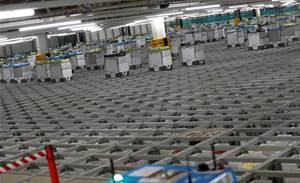 "Britain's Ocado to open first ""mini"" robotic warehouse"