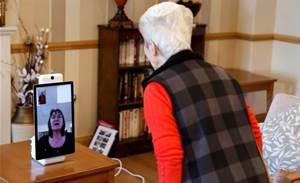 Elderly in UK care home embrace technology to beat coronavirus lockdown
