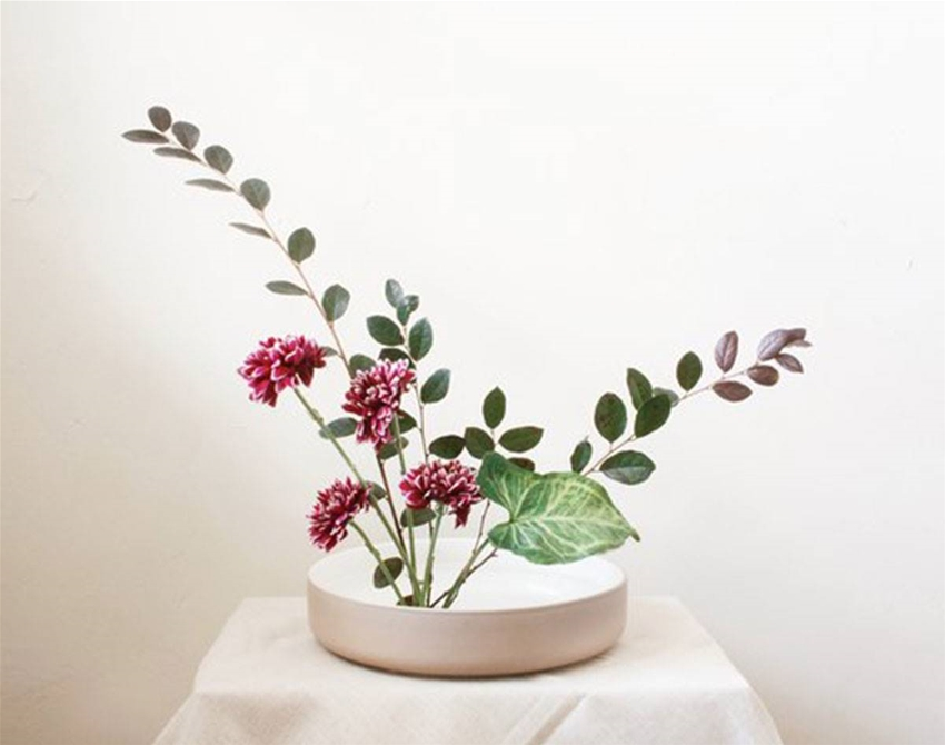 how to create an ikebana-inspired floral arrangement