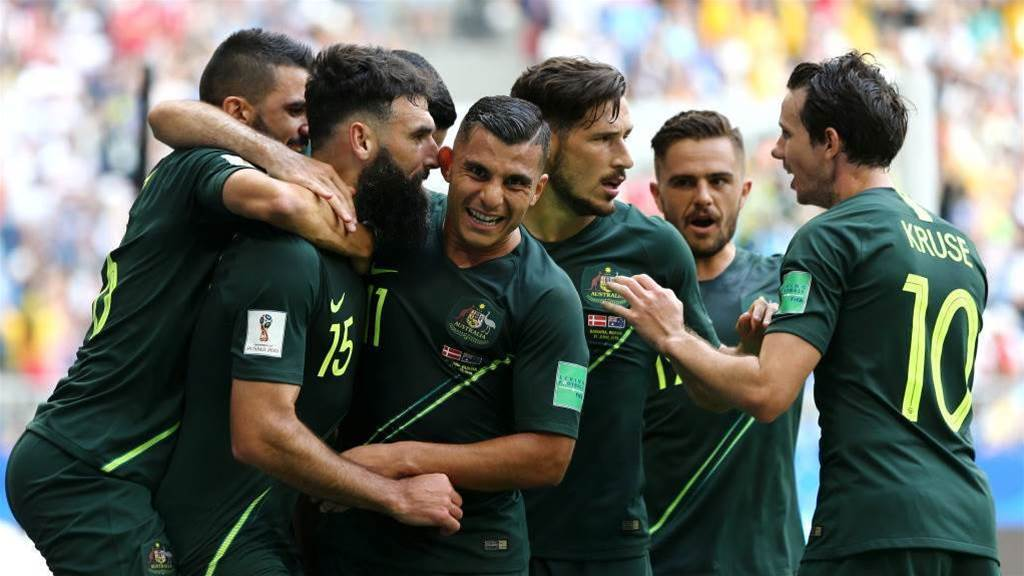 Socceroos still alive in World Cup after Denmark draw