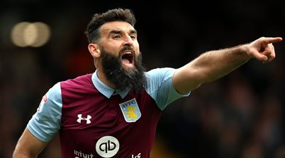 Jedinak takes up coaching role