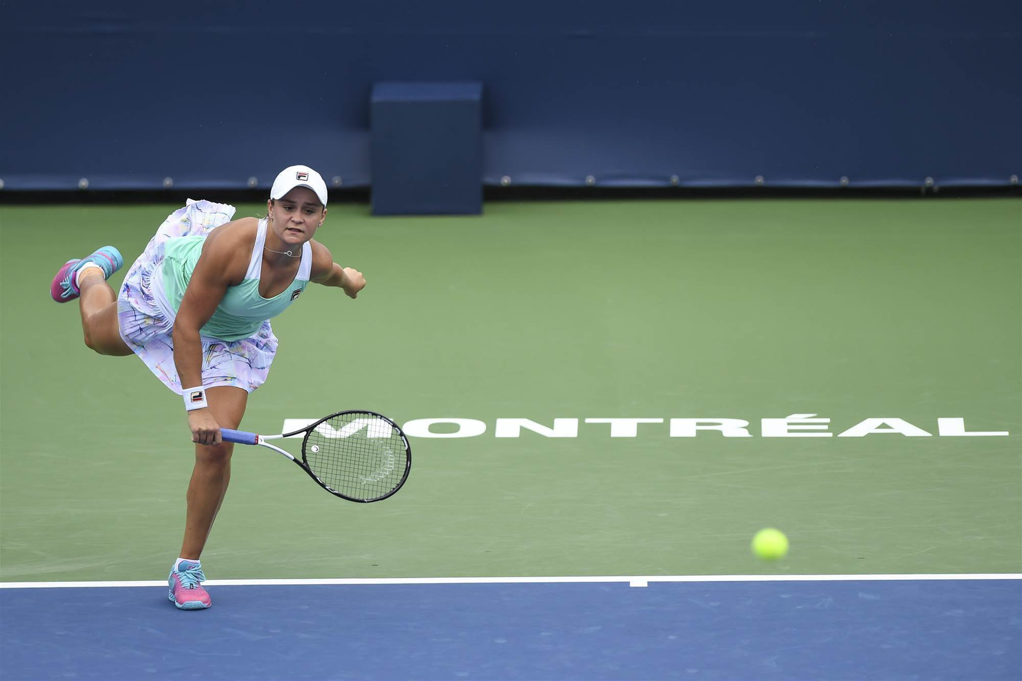 Barty moves on in Canada