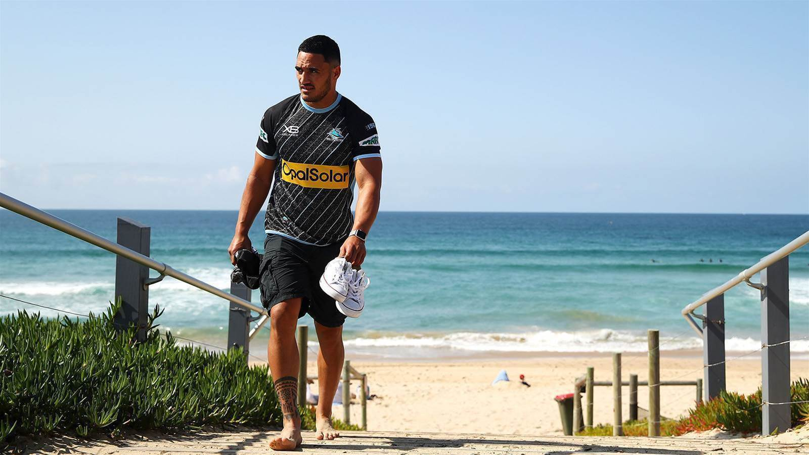 Sharks free Holmes for gridiron tilt
