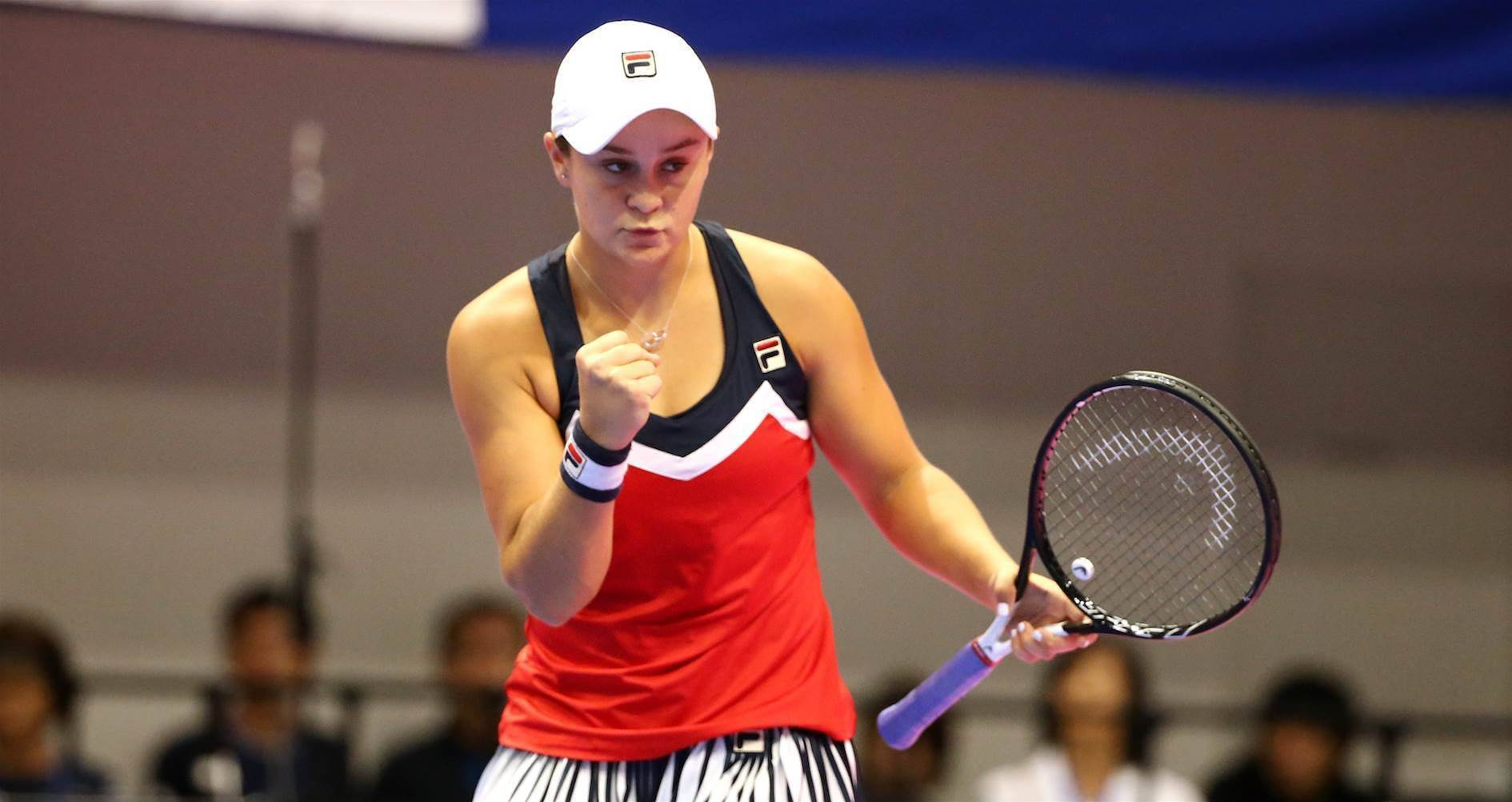 Barty wins battle of the doubles partners