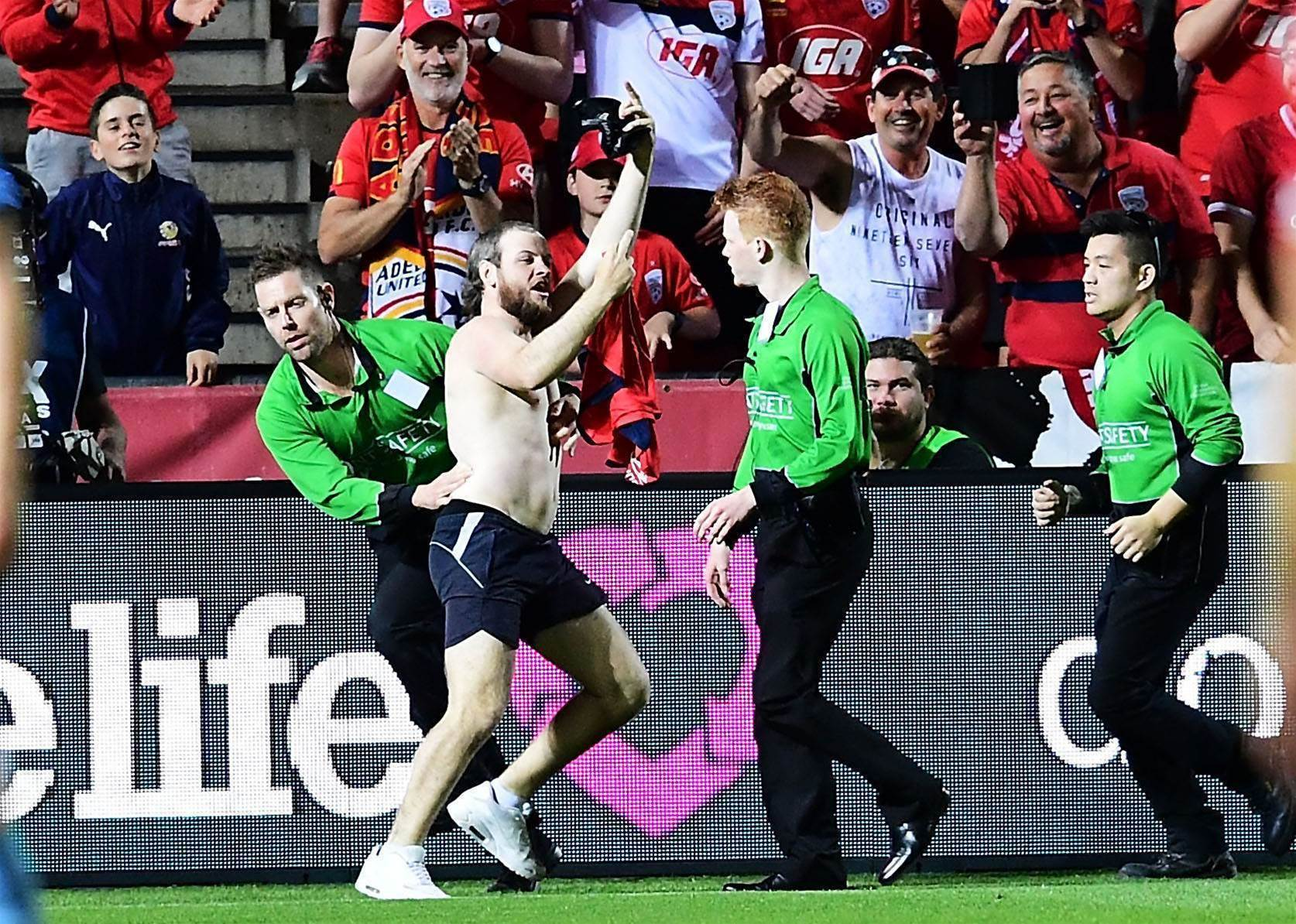 WATCH! Pitch invader's glorious FFA Cup Final stack