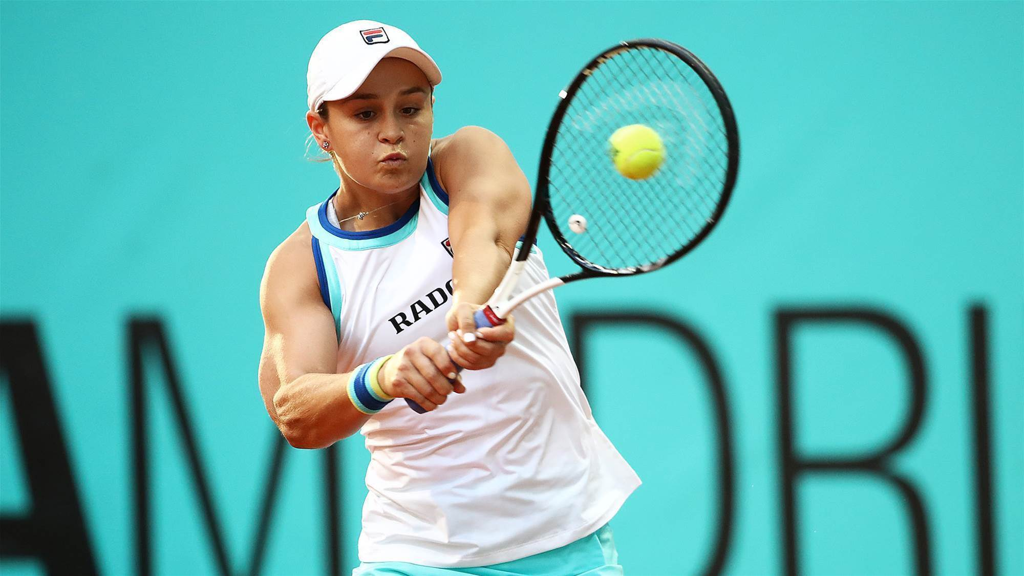 Barty charges on in Madrid