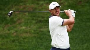 Koepka banking on caddie Elliott at Open