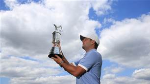 Molinari happy for low-key title defence