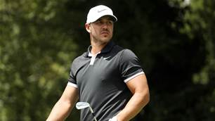 Leader Koepka blasts photo-shoot critics