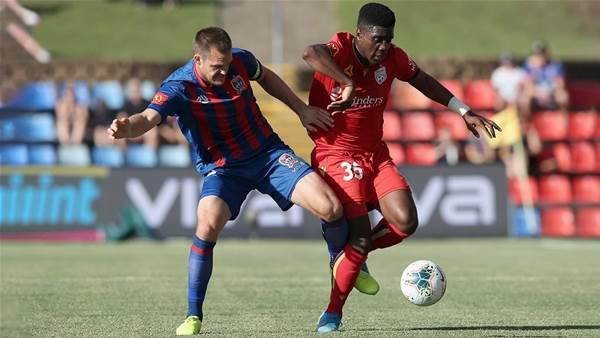 Adelaide attacker Toure opts for Australia