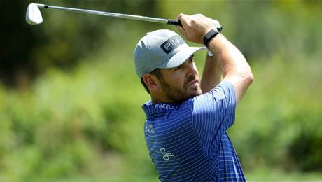 Oosthuizen charges to lead in South Africa