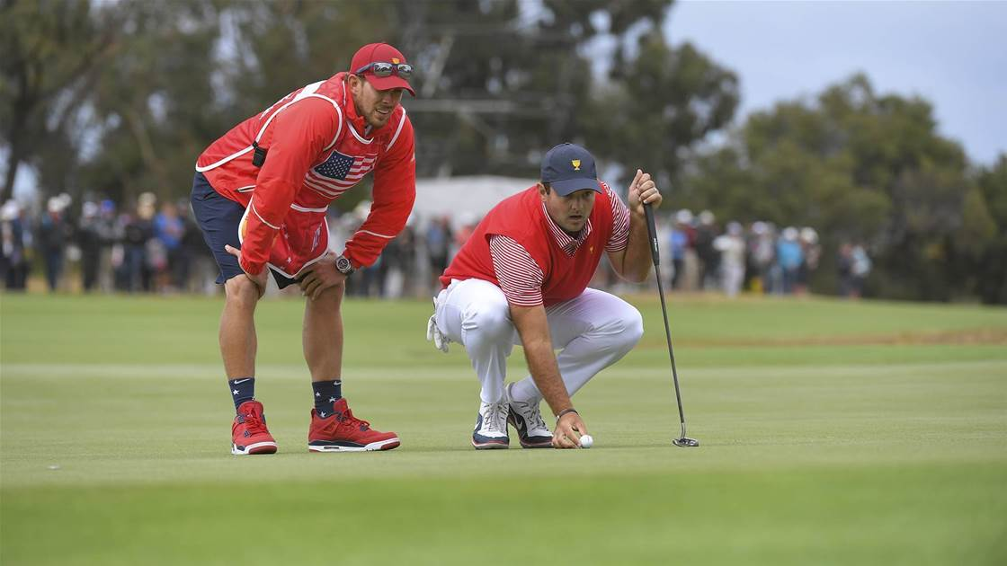 Patrick Reed's caddie banned after clash with Cup fan