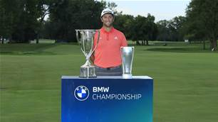 Rahm's monster putt downs DJ in BMW thriller