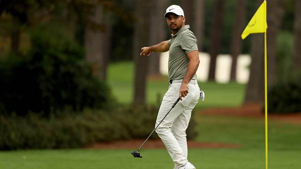 Day dials in putter for Masters assault