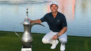 Casey runs away with Dubai Desert Classic