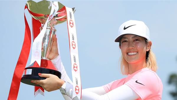 Wie drains huge putt to end title drought
