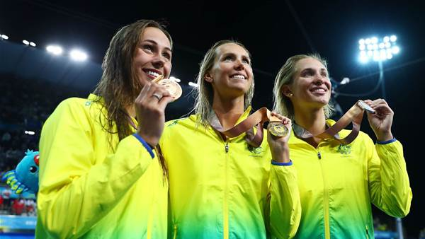 Gold, silver and bronze in the pool