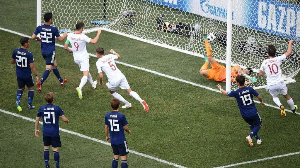 Japan reach round of 16 despite 1-0 loss to Poland