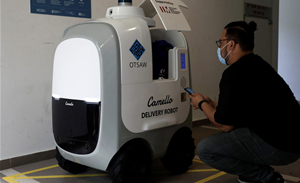 Robots on call for Singapore home deliveries