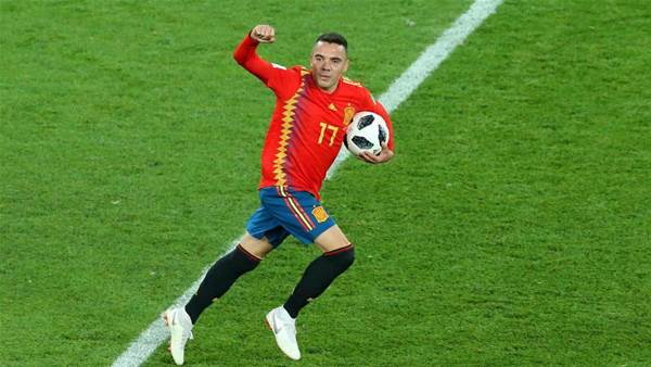 Spain finish top of Group B after salvaging 2-2 draw with Morocco
