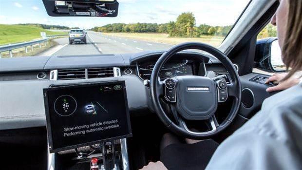 Uber suspends self-driving tests as pedestrian dies