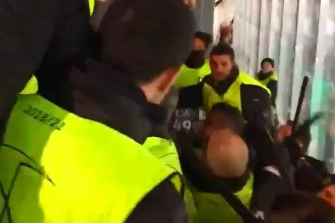 Spurs fans hit with batons by Spanish stewards