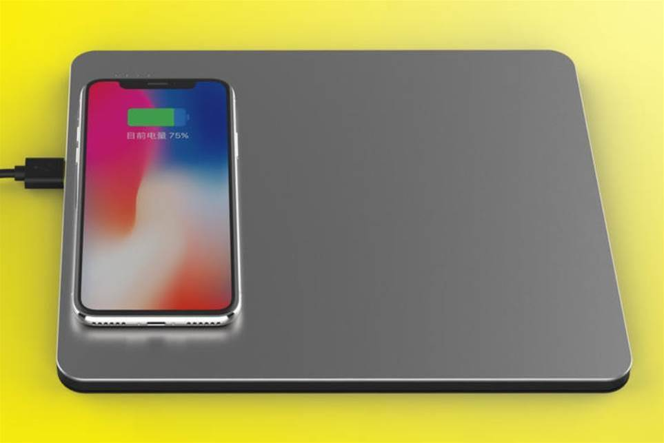 CEENIU Power Dock is a sleek aluminium mouse pad that can charge up to five devices at once