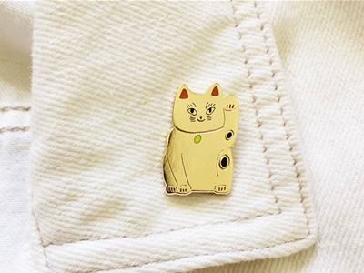 pin a lucky cat to your collar