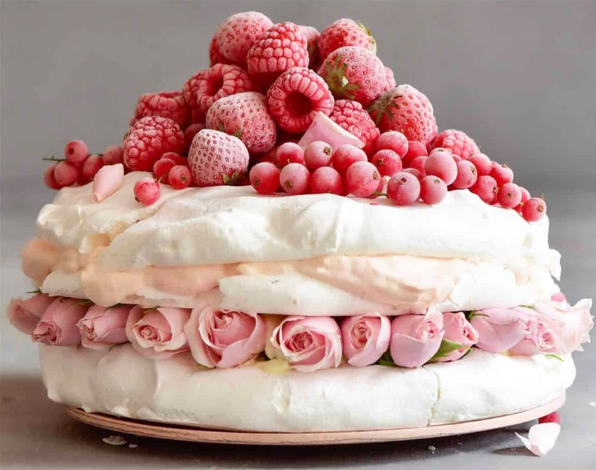 pavlova cake with whipped coconut cream and berries