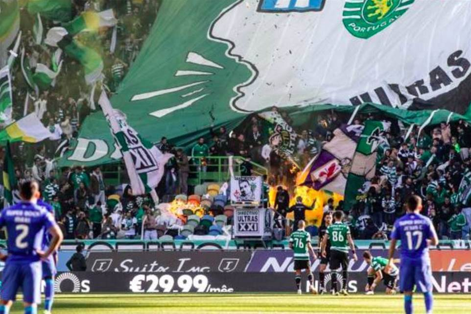 Watch! Sporting fans set fire to own stand