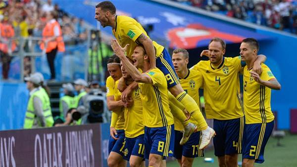 Sweden edge the Swiss to reach quarter-finals