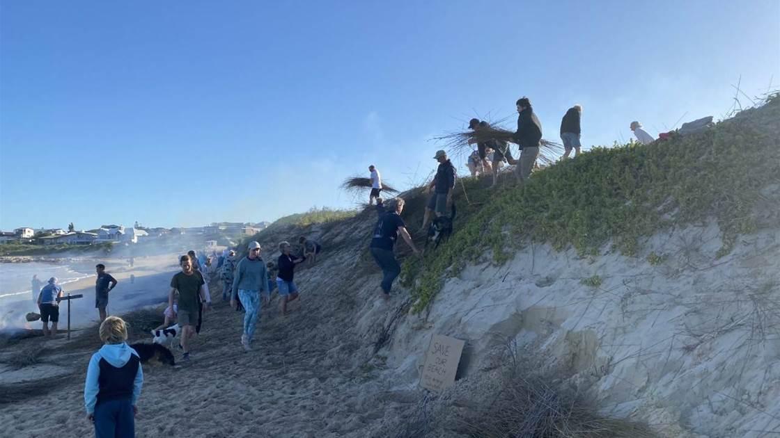 Surfers Claim Back Beach