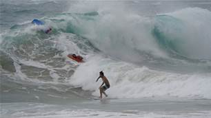 Watch: Mason Ho Ride Wild Hurricane Douglas Surf on Oahu