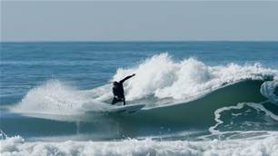 Watch: Dane Reynolds and Ethan Osborne Attempt to Tame a Wild Wedge.
