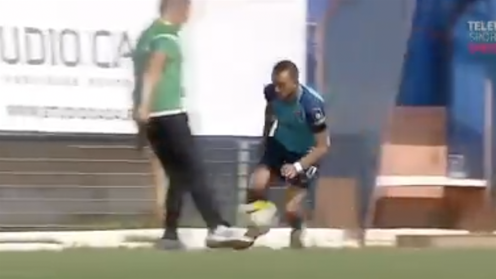 WATCH: Coach sent off for tripping rival player
