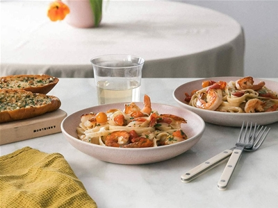 linguine with blistered tomatoes and prawns in lemon butter