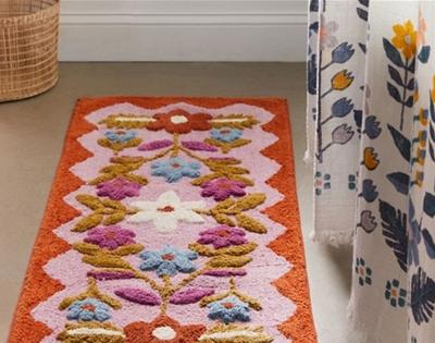 a fancy floral bath mat