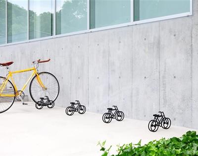 tiny bike-shaped bike stands