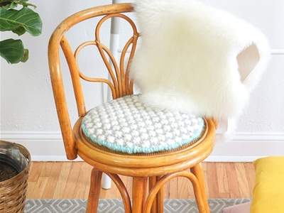 diy oversized cross-stitched cushion