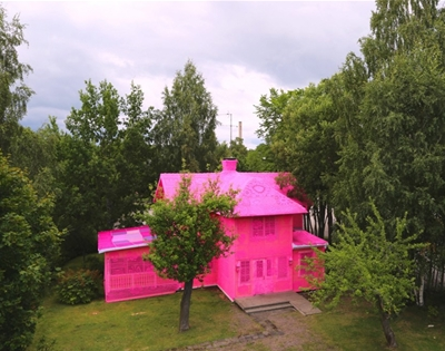 a pink crocheted house