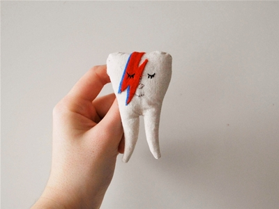 david bowie tooth brooch
