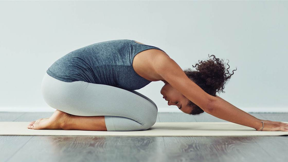 10 Best Stretches to Ease Your Lower Back Pain, According to Trainers